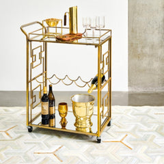 Y Cowhide Rug in room with brass bar cart