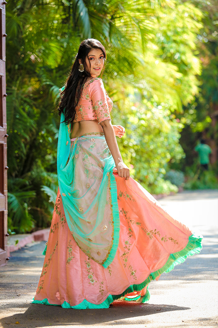 Peach Lehenga with  sea-green Dupatta