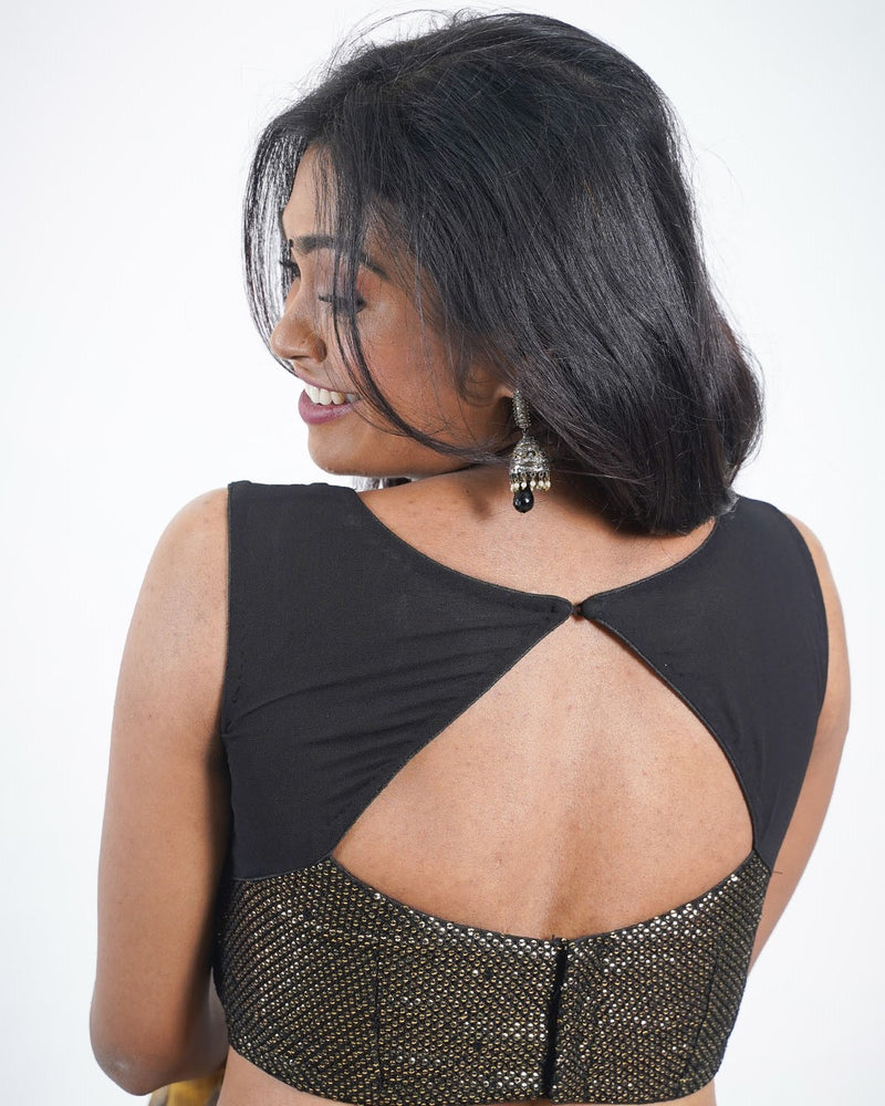 Black sleeveless sequins blouse