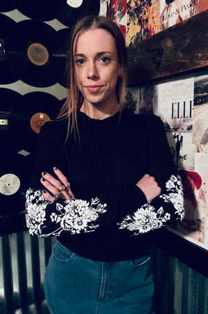 Flower on sleeve sweatshirt