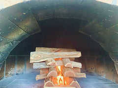 Starting the fire for Pizza Oven
