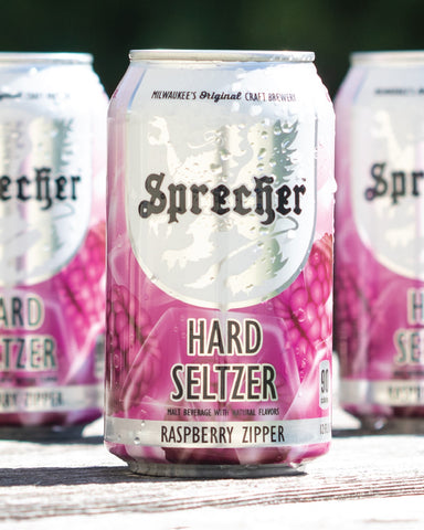 Three cans of Sprecher Raspberry Zipper hard seltzer