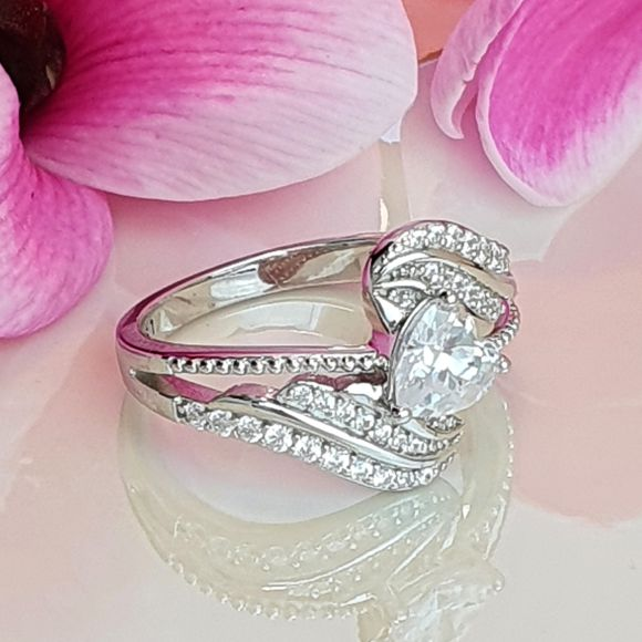 "<img src=""A_Hug_From_Above_Sterling_Silver_Ring_10.jpg"" alt=""Angel Jewelry - A Hug From Above Sterling Silver Ring"">"