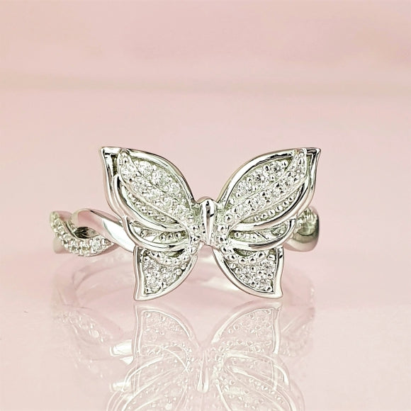 "<img src=""Brand_New_Day_Angel_Wings_Butterfly_Ring_6.jpg"" alt=""Angel Jewelry - Brand New Day Sterling Silver Angel Wings Butterfly Ring - 6"">"