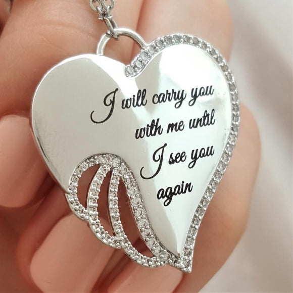 "<img src=""I_Carry_You_in_My_Heart_Angel_Wing_Necklace_1.jpg"" alt=""Angel Jewelry - I Carry You in My Heart Angel Wing Necklace - 1"">"