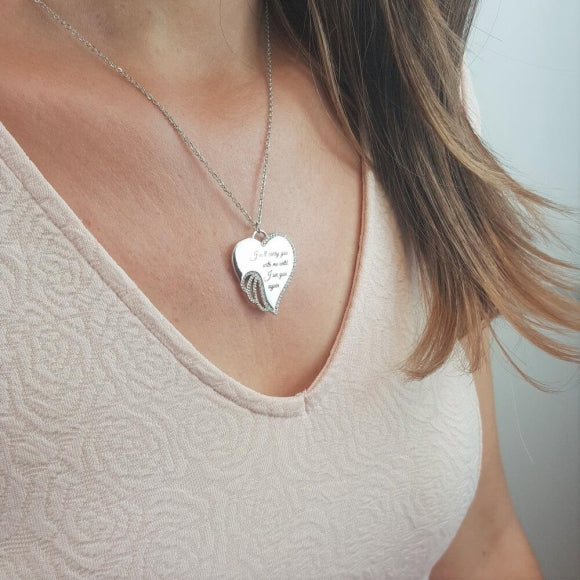 "<img src=""I_Carry_You_in_My_Heart_Angel_Wing_Necklace_2.jpg"" alt=""Angel Jewelry - I Carry You in My Heart Angel Wing Necklace - 2"">"