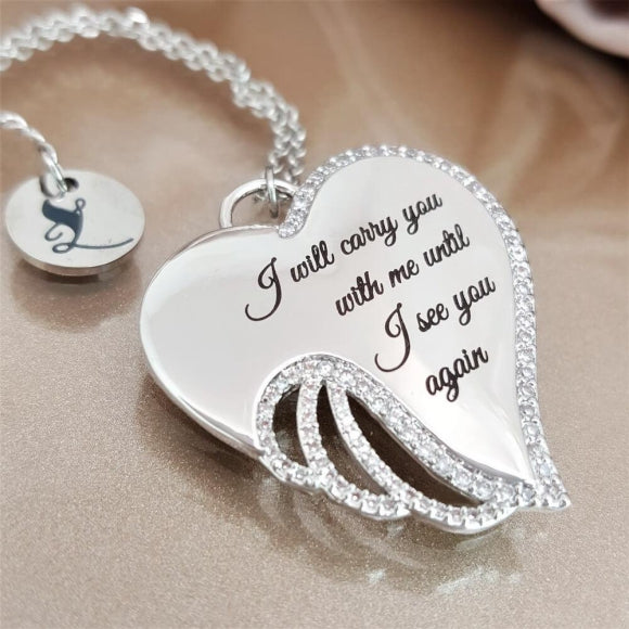 "<img src=""I_Carry_You_in_My_Heart_Angel_Wing_Necklace_3.jpg"" alt=""Angel Jewelry - I Carry You in My Heart Angel Wing Necklace - 3"">"