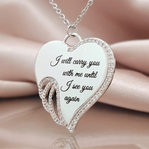 "<img src=""I_Carry_You_in_My_Heart_Angel_Wing_Necklace_4.jpg"" alt=""Angel Jewelry - I Carry You in My Heart Angel Wing Necklace - 4"">"