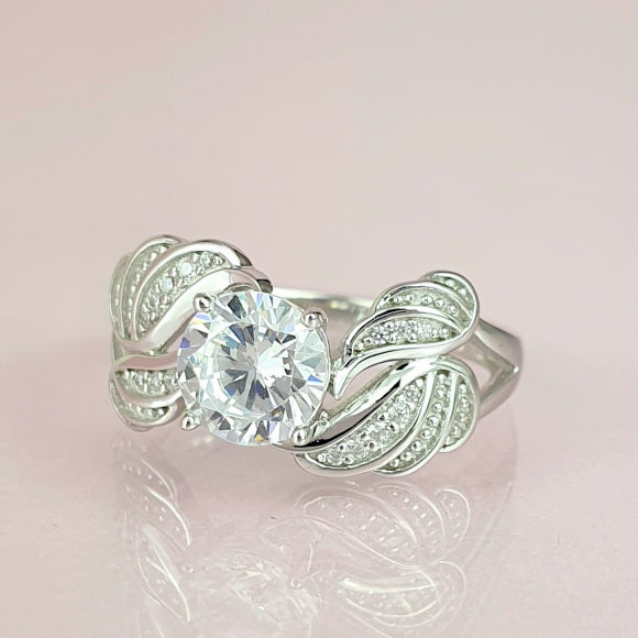 "<img src=""In_The_Arms_Of_An_Angel_Guardian_Ring_1.jpg"" alt=""Angel Jewelry - In The Arms Of An Angel Sterling Silver Guardian Ring - 1"">"