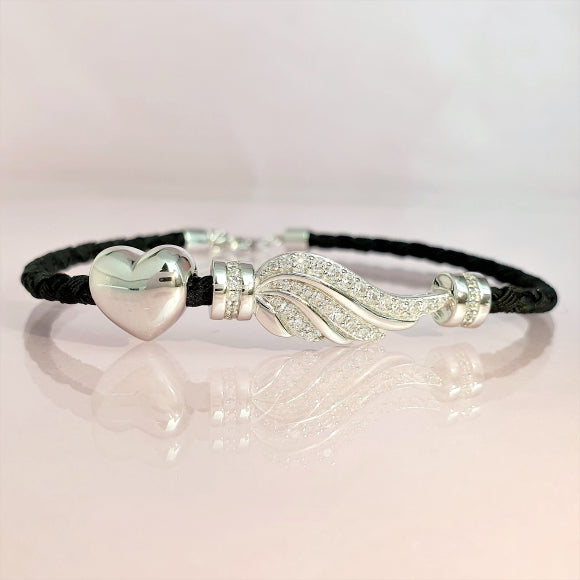"<img src=""Let_Love_Light_Your_Way_Friendship_Bracelet_4.jpg"" alt=""Angel Jewelry - Let Love Light Your Way Sterling Silver Friendship Bracelet - 4"">"