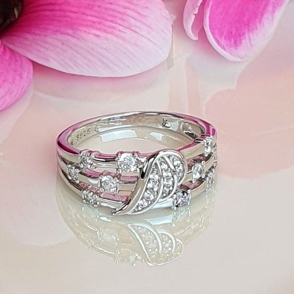 "<img src=""My_Dreams_Will_Come_True_Angel_Ring_11.jpg"" alt=""Angel Jewelry - My Dreams Will Come True Sterling Silver Angel Wing Ring - 11"">"