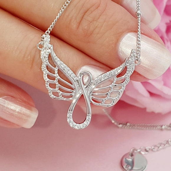 "<img src=""Protect_Me_Always_Angel_Wing_Infinity_Necklace_1.jpg"" alt=""Angel Jewelry - Protect Me Always Sterling Silver Angel Wing Infinity Necklace - 1"">"