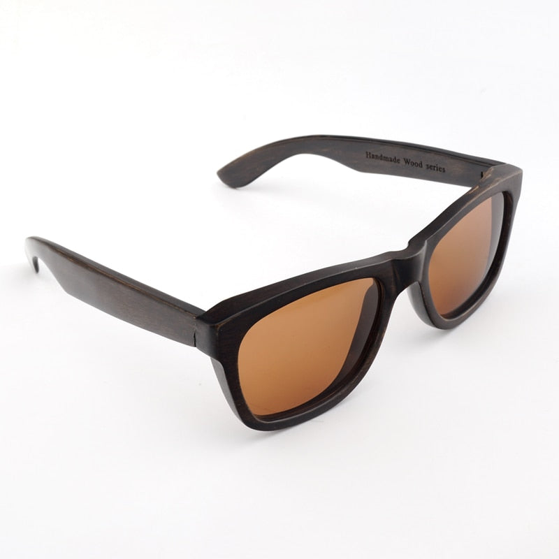 Dark wooden sunglasses with amber colored polarized lenses