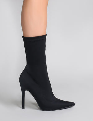 black pointed toe sock boots