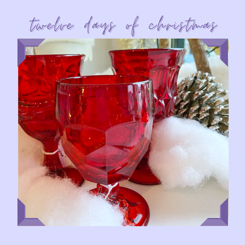 red vintage pressed glass goblets in festive setting