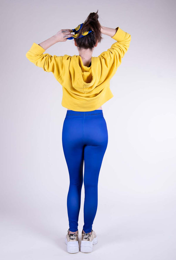 Blue leggings with a bright yellow face back view