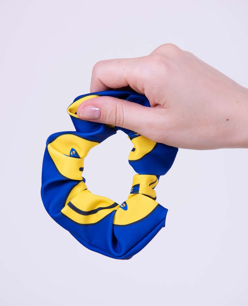 yellow smiling face on blue background scrunchy