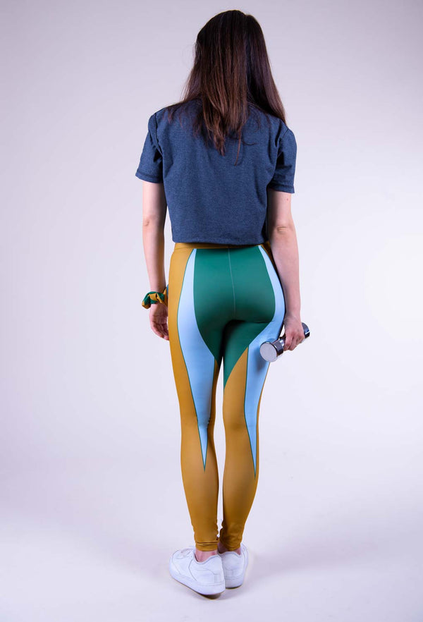 Geometric shapes on mustard yellow, green and light blue leggings back view