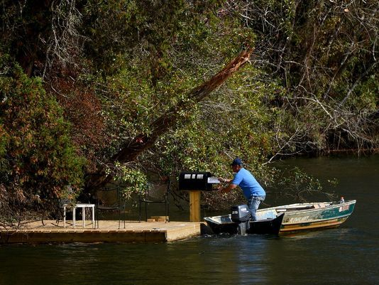 Hang out on Magnolia River and watch the only postal delivery… by boat… in the US.