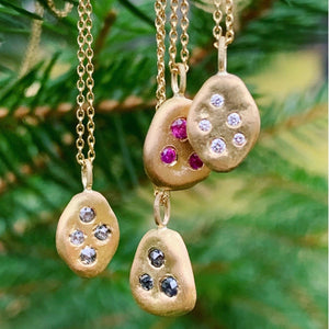 18k skipping stone gold pendants