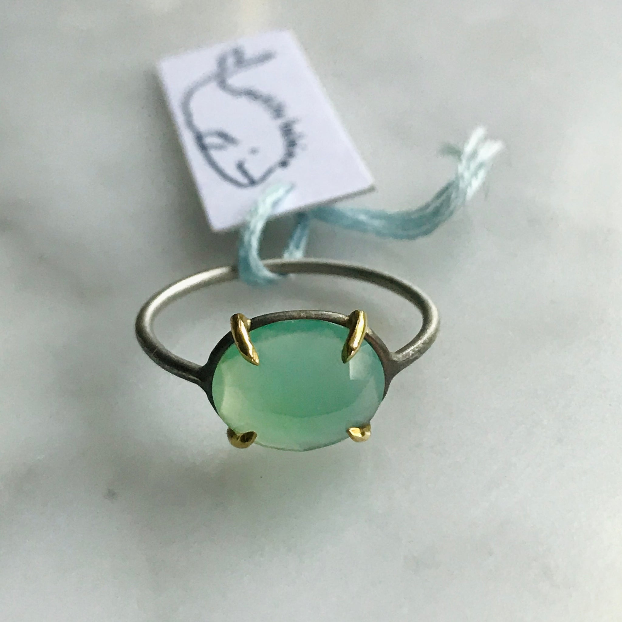 oval peruvian opal 18k gold prongs silver band