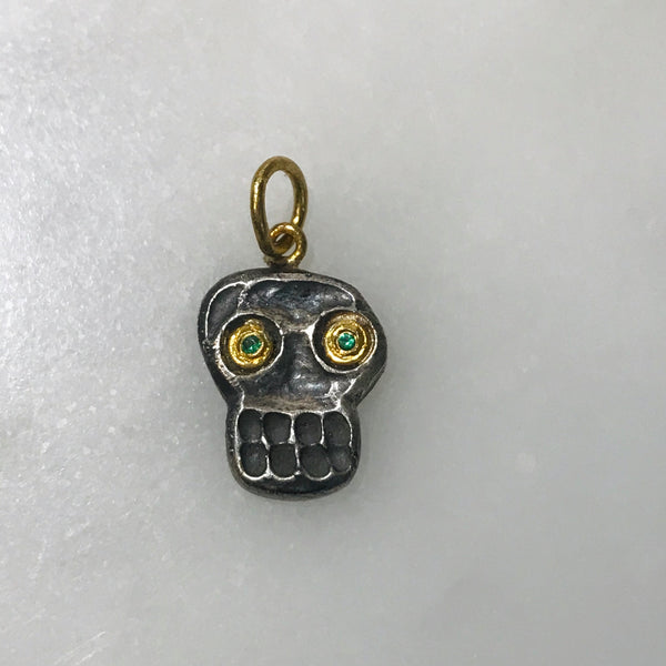silver, 24k gold, + emerald skull charm
