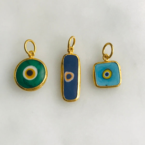 hand made 24k gold + quartz evil eye charms