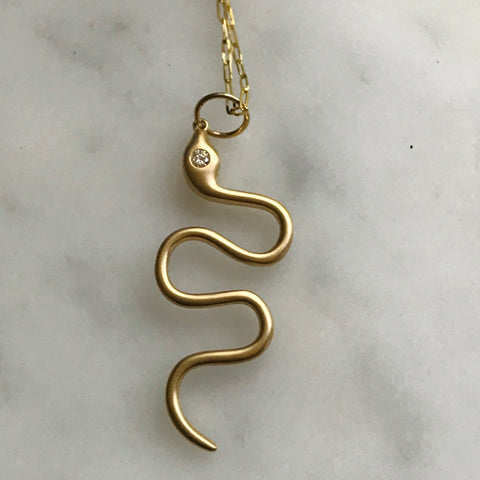 "snake necklace with diamond eye on 24"" gold chain. 14k"