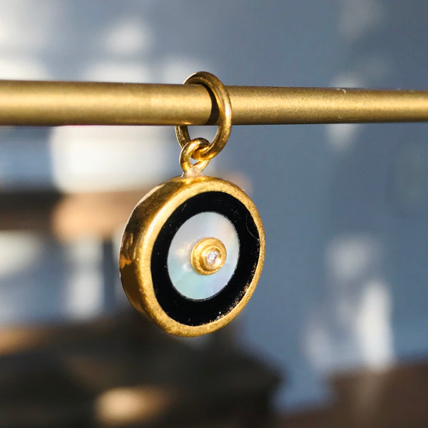 onyx, mother of pearl and diamond eye charm in 24k gold