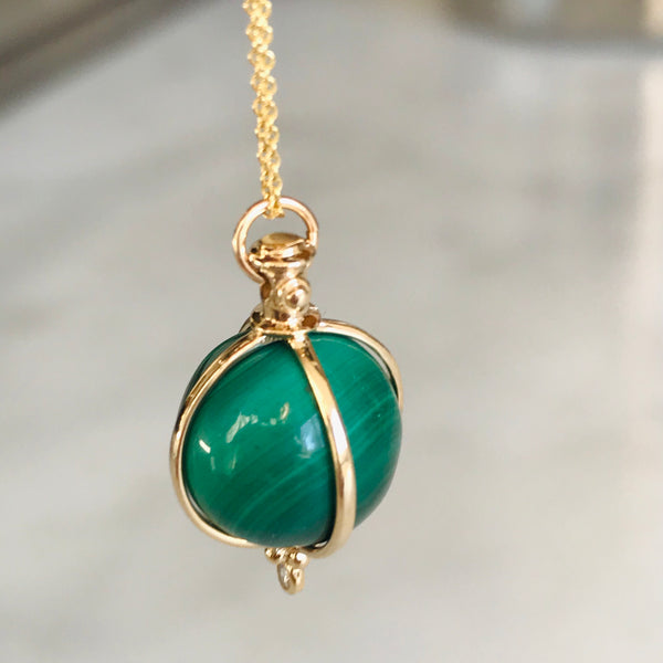 "malachite sphere with diamond set in 14k gold. 18"" gold chain"