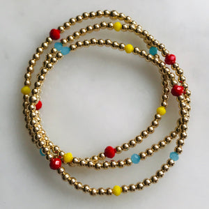 14k gold beaded bracelet with red, yellow and blue beads