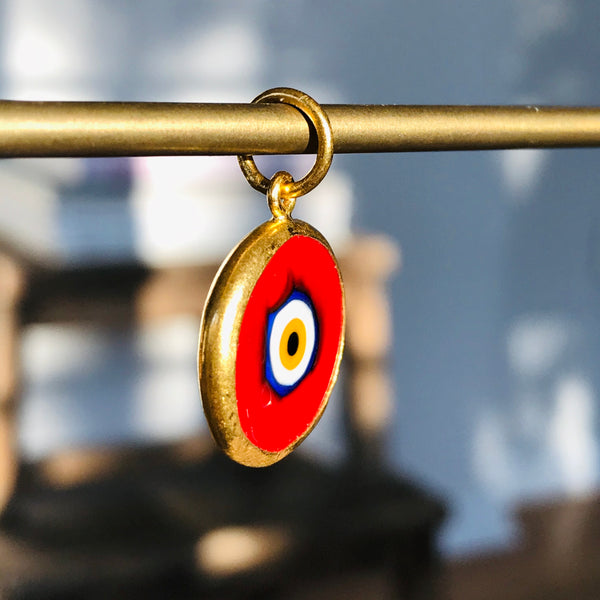 two sided red eye charm in 24k gold