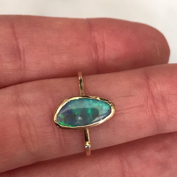 australian boulder opal ring with a diamond set in 18k gold