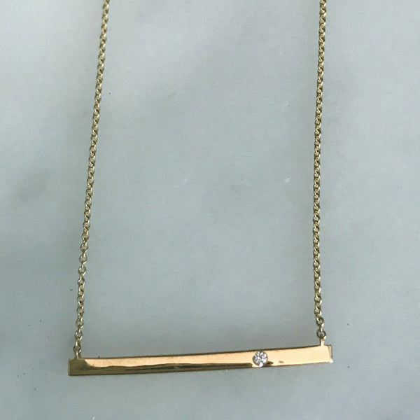 14k gold bar with a diamond necklace