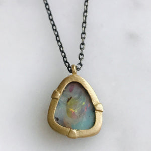 australian boulder opal set in 14k gold with a sterling silver + gold chain