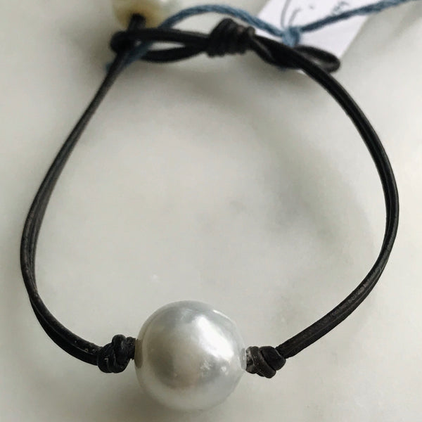 single pearl on leather bracelet