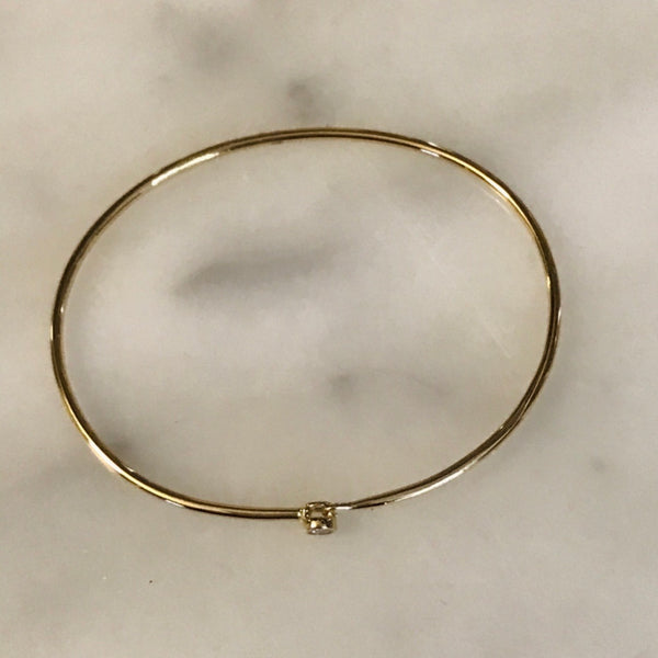 14k gold bangle with single diamond