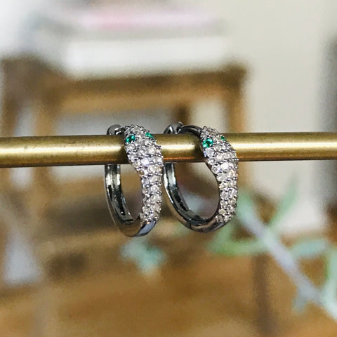 pavé diamond snake huggies with emerald eyes