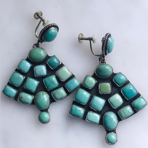 silver turquoise fan earrings. signed by the artist. twist backs.
