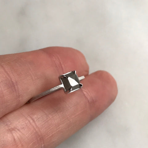grey diamond set in 18k white gold