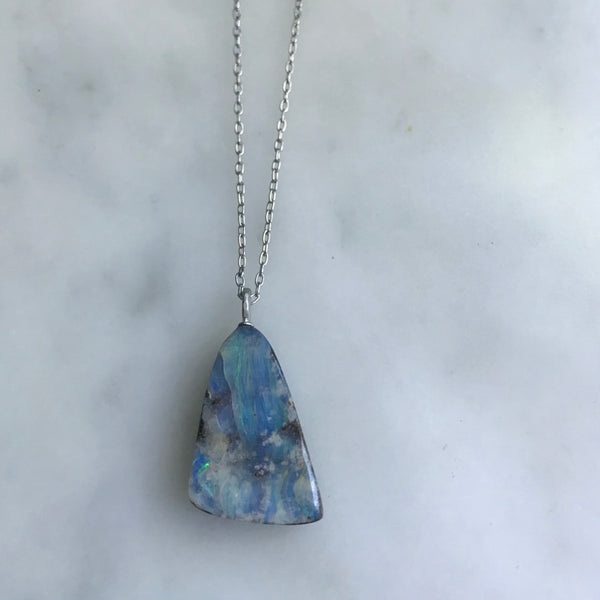 "triangle shaped boulder opal on an 18"" 14k white gold chain"