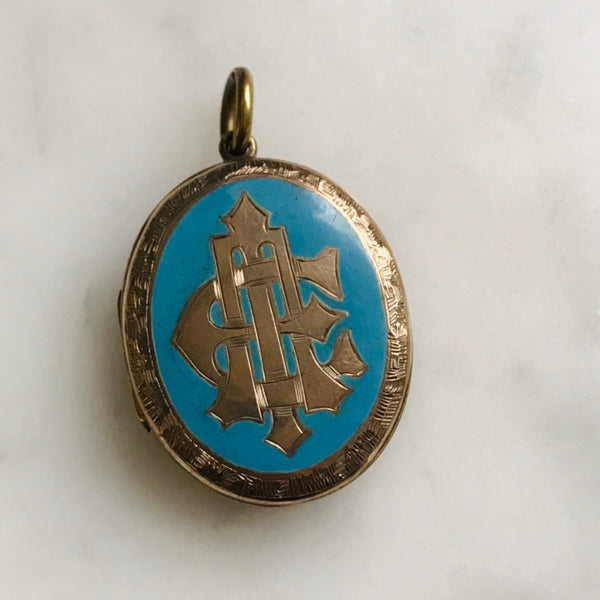victorian gold filled AEI blue enamel locket. hairwork interior.