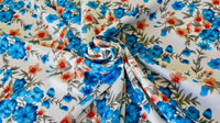 viscose-challis-fabric-floral-design-blue-peach-and-off-white-clothcontrol