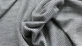 jersey-knit-fabric-black-and-grey-houndstooth-design-clothcontrol