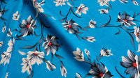 viscose-challis-fabric-lily-flower-design-on-blue-clothcontrol