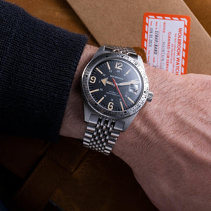 Skindiver WT Automatic Watch, Black Dial with Vintage Lum and Steel Case on wrist, close-up
