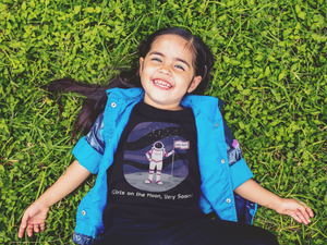 STEM girl wearing astronaut t-shirt