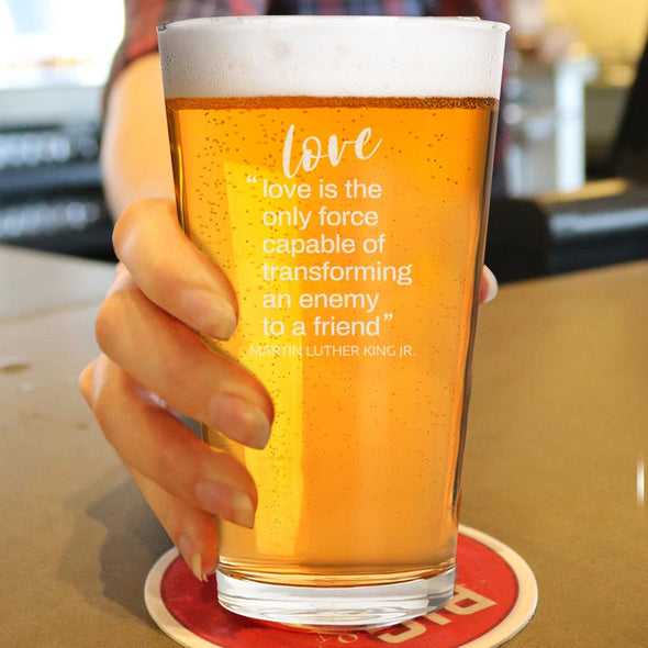 Love is the Only Force Capable of Transforming and Enemy - Pint Glass