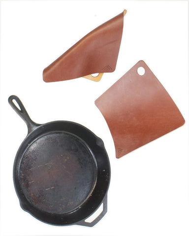 Square leather hot pads and cast iron pad