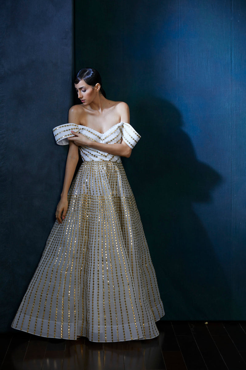 Ivory and gold off shoulder evening gown